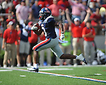 Ole Miss running back Jeff Scott (3) scores on a 55 yard touchdown pass vs. Auburn at Vaught-Hemingway Stadium in Oxford, Miss. on Saturday, October 13, 2012.