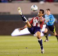 Chivas USA defender Mariano Trujillo (8) redirecting the ball. CD Chivas USA defeated the San Jose Earthquakes 3-2 at Home Depot Center stadium in Carson, California on Saturday April 24, 2010.  .