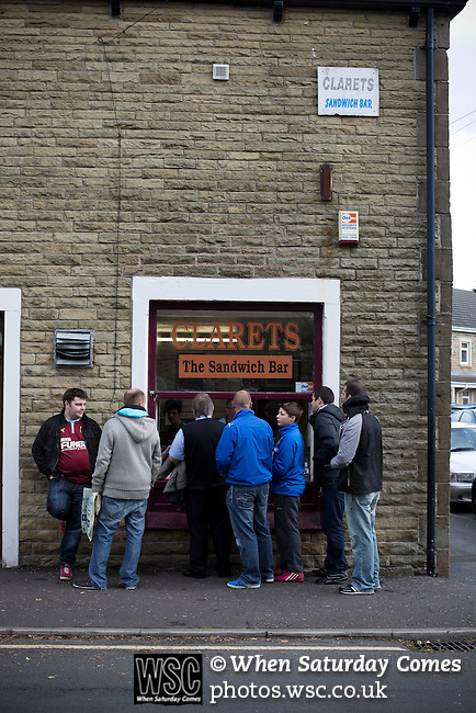 Burnley 1 West Ham United 3, 18/10/2014. Turf Moor, Premier League. Home supporters at the Clarets Sandwich Bar near Turf Moor, home of Burnley FC, before the club hosted West Ham United in an English Premier League match. The fixture was won by the visitors by three goals to one watched by 18,936 spectators. The defeat meant that Burnley still had not won a league match since being promoted from the Championship the previous season. Photo by Colin McPherson.