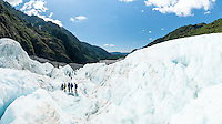 Group of people hiking on Franz Josef Glacier, Westland Tai Poutini National Park, West Coast, UNESCO World Heritage Area, New Zealand, NZ