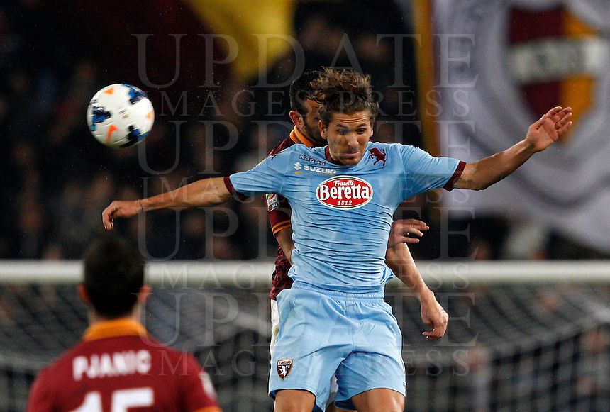 Calcio, Serie A: Roma vs Torino. Roma, stadio Olimpico, 25 marzo 2014.<br /> AS Roma defender Leandro Castan, of Brazil, and Torino midfielder Alessio Cerci, right, jump for the ball during the Italian Serie A football match between AS Roma and Torino at Rome's Olympic stadium, 25 March 2014.<br /> UPDATE IMAGES PRESS/Riccardo De Luca