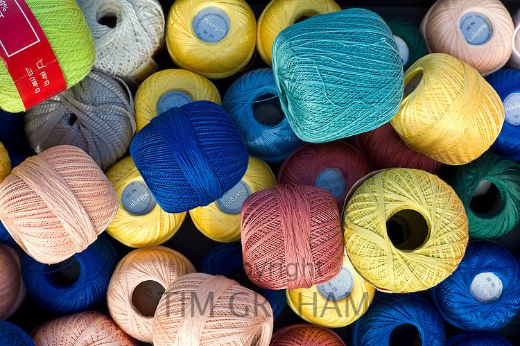 Cotton reels for crochet work on sale at street market in La Reole, Bordeaux region of France