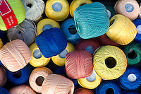 Cotton reels for crochet work on sale at street market in La Reole, Bordeaux region of France