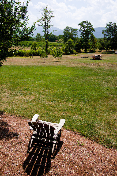 Chairs and benches are arranged around the property at Veritas Vineyards, offering quiet places to sit and enjoy the lawns, vineyard views, and surrounding Blue Ridge.