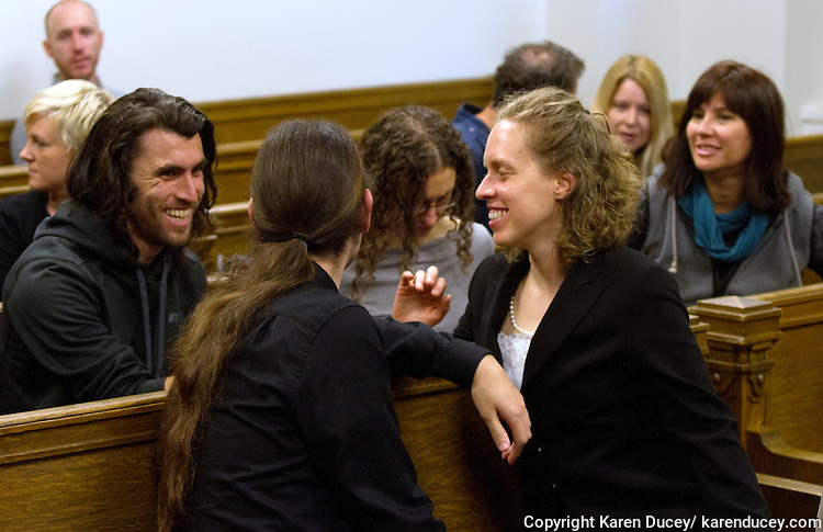Amanda Schemkes (right) and activists from Don't Expand UW Primate Testing shortly after winning their case. In a King County Superior Courtroom activists from Don't Expand UW Primate Testing are suing the University of Washington Board of Regents for violating the state's Open Public Meetings Act (OPMA) in Seattle, Wash. on April 24, 2015. The group led by Seattle University law student Amanda Schemkes alleged the UW was discussing official business at the Board's private dinner meetings held the night before public meetings at the residence of the UW President. They cited this happened 24 times since 2012. Of particular concern to the group was a dinner meeting held in November 2013 where the Board decided to build a new Animal Research and Care Facility without public input. Judge Laura Inveen ruled in their favor.  (© Karen Ducey Photography)