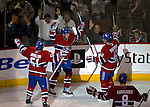 3 February 2007: Montreal Canadiens defenseman Mark Streit of Switzerland (center) celebrates the Canadiens' second goal with teammates Francis Bouillon (51) and Alexander Perezhogin (42) of Kazakhstan in the second period against the New York Islanders at the Bell Centre in Montreal, Canada. The Islanders defeated the Canadiens 4-2.Mandatory Photo Credit: Ed Wolfstein Photo *** Editorial Sales through Icon Sports Media *** www.iconsportsmedia.com