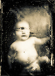Sepia photograph of infant cyclops