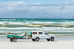 Trek net wooden rowing boat and towing vehicle parked on the beach, Strandfontein beach, False Bay, Cape Town, Western Cape, South Africa