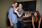 Bartender Alex Flynn, center.
