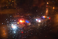 Lights from vehicles outside a rain drop splattered window during Hurricane Sandy on Monday, October 29, 2012. Hurricane Sandy roared into New York disrupting the transit system and causing widespread power outages.  (© Richard B. Levine)