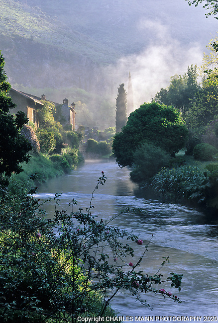 A morning mist rises above the Ninfa River at the Ninfa gardens a few miles southof Rome.