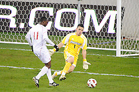 Providence Friars goalkeeper Jhojan Obando (1) comes off his line to defend Andre Sharpe (11) of the Cincinnati Bearcats. The Providence Friars defeated the Cincinnati Bearcats 2-1 during the semi-finals of the Big East Men's Soccer Championship at Red Bull Arena in Harrison, NJ, on November 12, 2010.