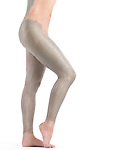 Woman with bentonite clay body wrap mask on her legs and back