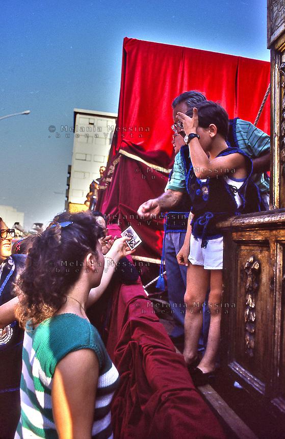 Palermo, feast of Saint Rosalia:fundraising by offers for holy images.<br /> Palermo, festino di Santa Rosalia: raccolta di fondi con le offerte per i santini