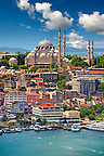 The Suleymaniye Mosque (Süleymaniye Camii, 1550-1558)  on the Third Hill with a ferries on the banks of the Golden Horn in the foreground, Istanbul Turkey.