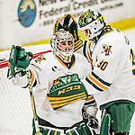 24 October 2015: University of Vermont Catamount Goaltender Mike Santaguida, a Junior from Mississauga, Ontario, is consoled by fellow Goaltender Pat Feeley, a Junior from Winthrop, MA, after a game against the University of North Dakota at Gutterson Fieldhouse in Burlington, Vermont. North Dakota defeated the Catamounts 5-2 in the second game of their weekend series. Mandatory Credit: Ed Wolfstein Photo *** RAW (NEF) Image File Available ***