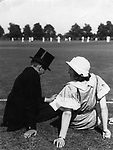Flirt. Eton boy in top hat and mother