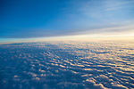 view from 40,000 feet of clouds and landscape