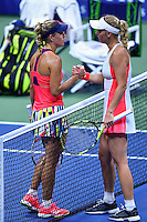 NEW YORK, USA - SEPT 09, Angelique Kerber of Germany shakes hands with Caroline Wozniacki of Denmark after defeating her during their Women's Singles Semifinal Match of the 2016 US Open at the USTA Billie Jean King National Tennis Center on September 8, 2016 in New York.  photo by VIEWpress