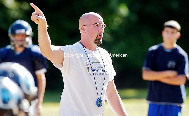 OXFORD, CT--17 September 07--091707TJ02 - Joe Stochmal, Oxford High School's head football coach, leads offensive practice on Monday, September 17, 2007. T.J. Kirkpatrick/Republican-American