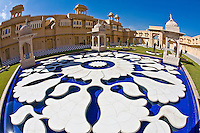 Udaivilas Oberoi Hotel with ornamental water fountain with artistically carved flowers in the courtyard. (Photo by Matt Considine - Images of Asia Collection)