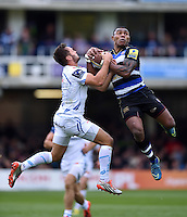 Semesa Rokoduguni of Bath Rugby competes for the ball in the air with Phil Dollman of Exeter Chiefs. Aviva Premiership match, between Bath Rugby and Exeter Chiefs on October 17, 2015 at the Recreation Ground in Bath, England. Photo by: Patrick Khachfe / Onside Images