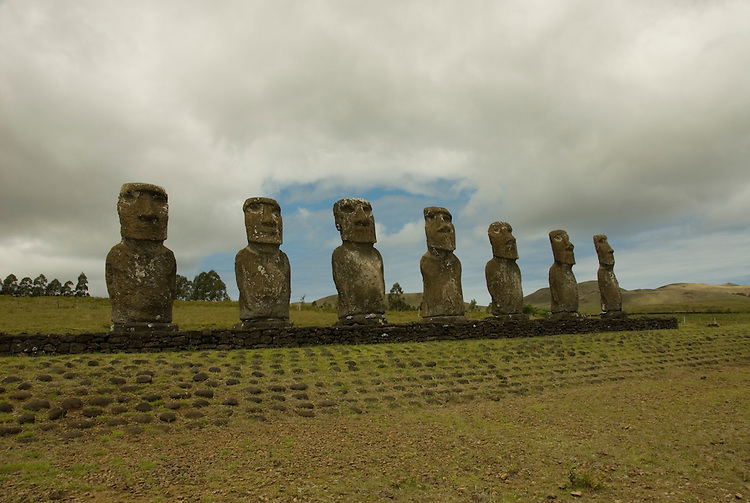 Chile, Easter Island: Statues or moai on a platform or ahu at Ahu Akivi, an inland array of moai, unusual because most moai face inland from the edge of the sea..Photo #: ch296-33140.Photo copyright Lee Foster www.fostertravel.com lee@fostertravel.com 510-549-2202