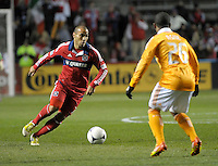 Chicago midfielder Alex (71) makes a move against Houston defender Corey Ashe (26).  The Houston Dynamo defeated the Chicago Fire 2-1 in the Eastern Conference play-in game for the MLS Playoffs at Toyota Park in Bridgeview, IL on October 31, 2012.