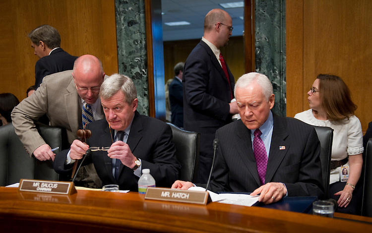 WASHINGTON, DC - May 12: Surrounded by aides, Chairman Max Baucus, D-Mont., and ranking member Orrin G. Hatch, R-Utah, prepare for the Senate Finance hearing hearing with John Watson, chairman and CEO of Chevron Corp.; Marvin Odum, U.S. President of Shell Oil Co.; James Mulva, chairman and CEO of ConocoPhillips; H. Lamar McKay, chairman and president of BP America Inc.; and Rex Tillerson, chairman and CEO of Exxon Mobil Corp.; on oil and gas tax incentives. (Photo by Scott J. Ferrell/Congressional Quarterly)