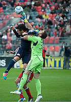 22 October 2011: New England Revolution forward Milton Caraglio #9 and Toronto FC goalkeeper Milos Kocic #30 in action during a game between the New England Revolution and Toronto FC at BMO Field in Toronto..The game ended in a 2-2 draw.