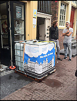 BNPS.co.uk (01202 558833)<br /> Pic: Hemelswater/BNPS<br /> <br /> The large container that is used to collect the rainwater.<br /> <br /> An entrepreneur is taking advantage of the wet weather by brewing beer from rainwater. <br /> <br /> Dutchmen Joris Hoebe founded Hemelswater, which translates to 'heaven's water', after hearing worrying reports that increased rainfall in his country, much like in the UK, is linked to climate change. <br /> <br /> Joris experimented with the idea in his kitchen before taking the plunge by installing two gigantic 500 litre tanks on the grounds of the University of Amsterdam. <br /> <br /> Code Blonde is currently selling in bottles and from draught at 30 bars and restaurants across the Dutch capital for &euro;2 (&pound;1.70) or &euro;4 or (&pound;3.40) respectively.