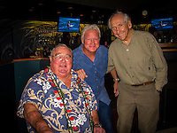 """HONOLULU, Turtle Bay Resort, North Shore, Oahu. - (Thursday, January 3, 2013) Greg Noll (USA) with Randy Rarick (HAW) and Peter Cole (USA) was the guest  speaker of Talk Story at Surfer The Bar tonight, Noll, nicknamed """"Da Bull"""" by Phil Edwards in reference to his physique and way of """"charging"""" down the face of a wave is an American pioneer of big wave surfing and is also acknowledged as a prominent longboard shaper. Noll was a member of a US lifeguard team that introduced Malibu boards to Australia around the time of the Melbourne Olympic Games. Noll became known for his exploits in large Hawaiian surf on the North Shore of Oahu. He first gained a reputation in November 1957 after surfing Waimea Bay in 25-30 ft surf when it had previously been thought impossible even to the local Hawaiians. He is perhaps best known for being the first surfer to ride a wave breaking on the outside reef at the so-called Banzai Pipeline in November 1964...It was later at Makaha, in December 1969, that he rode what many at the time believed to be the largest wave ever surfed. After that wave and the ensuing wipeout during the course of that spectacular ride down the face of a massive dark wall of water, his surfing tapered off and he closed his Hermosa Beach shop in the early 1970s. He and other surfers such as Pat Curren, Mike Stang, Buzzy Trent, George Downing, Mickey Munoz, Wally Froyseth, Fred Van Dyke and Peter Cole are viewed as the most daring surfers of their generation...Noll is readily identified in film footage while surfing by his now iconic black and white horizontally striped """"jailhouse"""" boardshorts and was interviewed by host Jodi Wilmott (AUS). . Photo: joliphotos.com"""