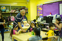 Teacher Mr. Mohamed Mamdouh distributes flashcards to the students. First and second graders learn Arabic at P.S. 368-Hamilton Heights School in Harlem in New York on Wednesday, May 23, 2012. The program is the first at the K-5 school level in New York City Public Schools.  © Frances M. Roberts)