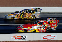 Apr 7, 2006; Las Vegas, NV, USA; NHRA Funny Car driver Tony Pedregon driving the Quaker State Racing Chevrolet Monte Carlo leads his brother, Cruz Pedregon driving the Advance Auto Parts Chevrolet Monte Carlo  during qualifying for the Summitracing.com Nationals at Las Vegas Motor Speedway in Las Vegas, NV. Mandatory Credit: Mark J. Rebilas