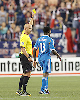 Yellow Card: Philadelphia Union substitute midfielder Michael Lahoud (13) from Jair Marrufo. In a Major League Soccer (MLS) match, the New England Revolution (dark blue) defeated Philadelphia Union (light blue), 5-1, at Gillette Stadium on August 25, 2013.