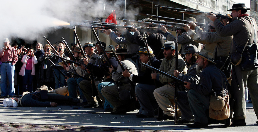 Participants take part in a Battle of Galveston reenactment as Confederate soldiers on the Strand in Galveston, Texas on Saturday, Jan. 14, 2012. The Battle of Galveston Reenactment was part of a series of events marking the 149th anniversary of the Civil War Battle of Galveston, in which Confederate troops regained control of Galveston Harbor.