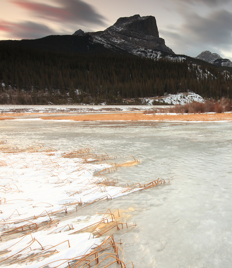 Clouds streak by in a time-exposure taken from a frozen lake in Jasper National Park, Alberta, Canada.
