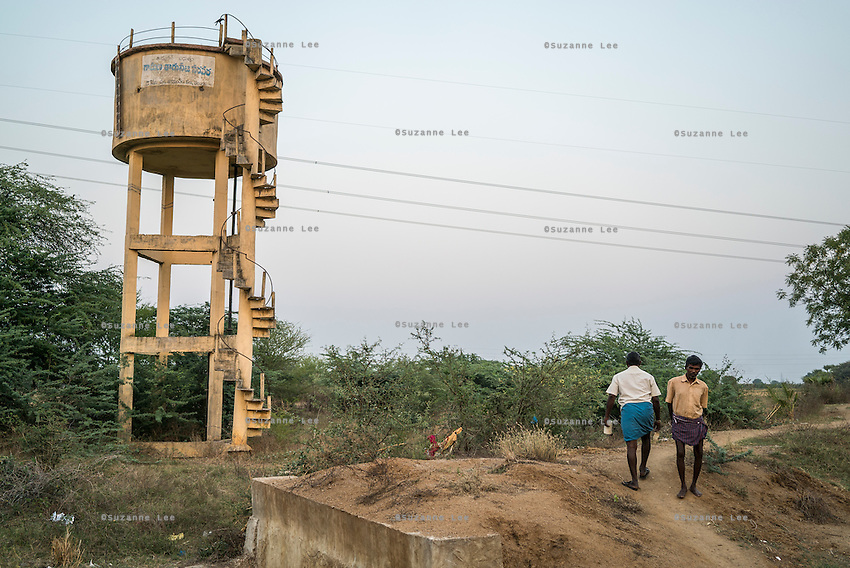 Villagers go about their daily lives in Koppula, a remote village in Warangal, Telangana, India, on 22nd March 2015. The government had built the water tank as seen 4 years ago, but never connected it with pipes, and it has been left disused, abandoned, and about to collapse, while the villagers continue to use bore wells as their water supply. Photo by Suzanne Lee/Panos Pictures for Safe Water Network