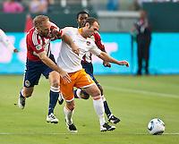 CARSON, CA – July 23, 2011: Chivas USA midfielder Simon Elliott (9) and Houston Dynamo midfielder Brad Davis (11) during the match between Chivas USA and Houston Dynamo at the Home Depot Center in Carson, California. Final score Chivas USA 3, Houston Dynamo 0.