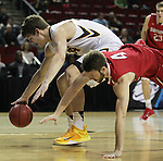 Iowa's Adam Woodbury (34)  goes for a loose ball against Davidson's Tyler Kalinoski (4) during the 2015 NCAA Division I Men's Basketball Championship's March 20, 2015 at the Key Arena in Seattle, Washington.  Iowa beat Davidson 83-52.    ©2015. Jim Bryant Photo. ALL RIGHTS RESERVED.
