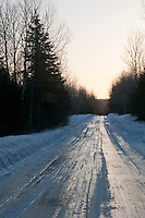 An ice covered road through the woods in Michigan's Upper Peninsula.