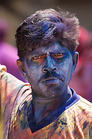 Indian man celebrating annual Hindu Holi festival of colours smeared with powder paints in Mumbai, formerly Bombay, Maharashtra, India