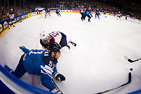 American Dylan Larkin (back) pushes Finland's Valtteri Filppula onto the sideline during the Ice Hockey World Championship quarter-final match between the US and Final in the Lanxess Arena in Cologne, Germany, 18 May 2017. Photo: Marius Becker/dpa /MediaPunch ***FOR USA ONLY***