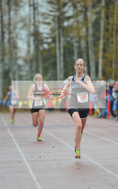 Eagle River's Paige McManus leads a trio of runners into the finish of the Region IV Cross Country Championships @ Bartlett High School Saturday, Sept 26, 2015.