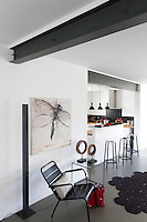 Industrial steels have been made a feature in the design of the open plan living/kitchen area