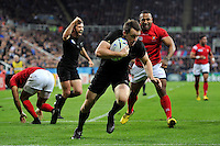 Ben Smith of New Zealand runs in a try in the first half. Rugby World Cup Pool C match between New Zealand and Tonga on October 9, 2015 at St James' Park in Newcastle, England. Photo by: Patrick Khachfe / Onside Images