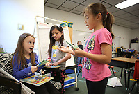 NWA Democrat-Gazette/DAVID GOTTSCHALK   Abigail Landers (from left), Makaylah Wilhite and Bella Broadway, all first grade students at West Fork Elementary School, interact in a mock book store Friday, April 7, 2017,  on a reward day in Misty Langston's class at the school. The district has more seniors than kindergarten students. Some of the trend is because of an aging population in West Fork, a lack of jobs within the city and a lack of housing. The high school is working to expand offerings to students, despite being a small school.