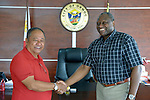 John Nduna (right), general secretary for the ACT Alliance, shakes hands with Edward Codilla, the mayor of Ormoc, a city in the Philippines province of Leyte that was hit hard by Typhoon Haiyan in November 2013. The storm was known locally as Yolanda. ACT Alliance members have been providing a variety of forms of assistance to survivors here, and Mayor Codilla wrote the Geneva-based network to express his appreciation. Nduna visited to Ormoc and other typhoon-affected communities in February 2014 to learn first hand about the network's emergency response and long-term plans for recovery and rehabilitation.