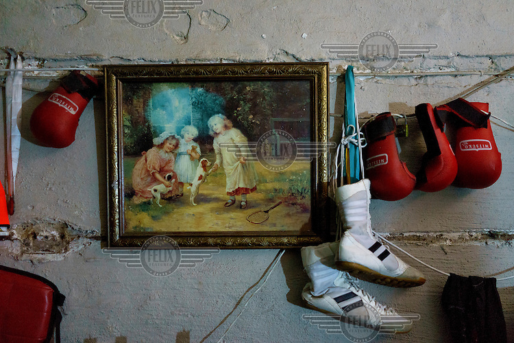 Siyakudumisa Vapi's boxing boots and pairs of child-sized boxing gloves hang next to a painting on the wall in his room. Currently living in a curtained-off space in the basement of the Hillbrow Boxing Club, he is training for a fight against the third-ranked fighter in the national featherweight division; if he wins it wil bring him closer to his objective of challenging for the national title and being able to make a decent living from boxing. Vapi believes boxing pulled him away from the streets and gave him discipline.  Hillbrow, in downtown Johannesburg, is the city's most notorious neighbourhood. It is overcrowded, ridden with illegal squats and suffers from high levels of crime much of which is related the thriving illicit drug trade. The gym has become a place of hope and discipline for local youth, keeping them of the streets and even producing some national champions.