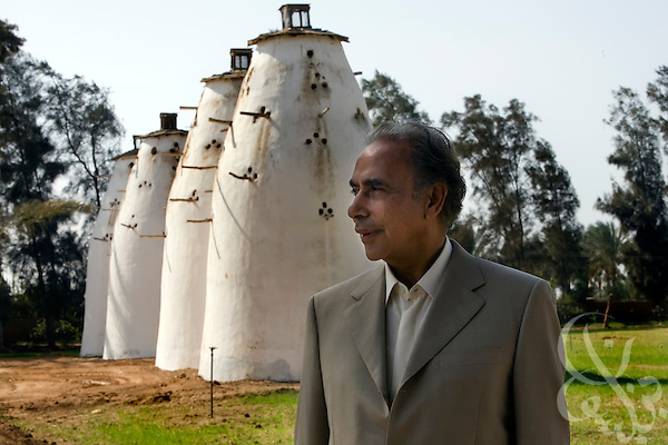 Dr. Ibrahim Abouleish, founder of Egyptian Organic Food and Product giant Sekem Group poses for a portrait in front of large concrete pigeon houses Nov 4, 2008 at the Sekem Farms complex in Belbeis, Egypt. In Egyptian culture, birdhouses are a symbol of success and one-ness with nature and so go hand in hand with the ideals for which Dr. Abouleish founded his organic food business and the larger community building ideas he wished it would help advance in Egypt.